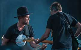 Pearl Jam bassist Jeff Ament and rhythm guitarist Stone Gossard on stage at Washington-Grizzly Stadium
