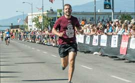 UM President Seth Bodnar finishes the Missoula Marathon