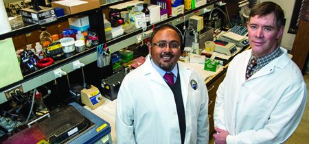 Sarj Patel and Tom Rau standing in a lab