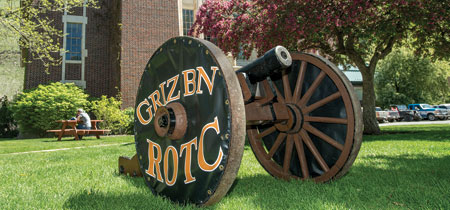 The Grizzly Battalion ROTC cannon sits in front of Schreiber Gymnasium.