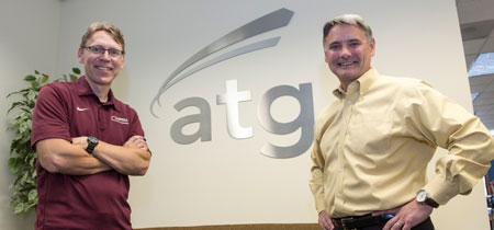 UM Professor David Firth, left, and Tom Stergios, vice president of Advanced Technology Group, have created a unique partnership that helps keep talented UM graduates in Montana working high-paying, high-tech jobs.