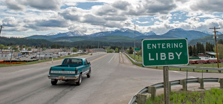 A sign welcomes visitors to Libby on a bridge crossing the Kootenai River. Residents of Libby are ready to move on from its tarnished past and focus on the future.
