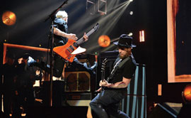 Pearl Jam bassist Jeff Ament and guitarist Mike McCready rock out at the Rock and Roll Hall of Fame induction ceremony at the Barclays Center in Brooklyn, New York, in April. (Photo by Getty Images)