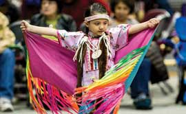 "Five-year-old Cianna Belle DesRosier of Browning (Maatsui Suipoyaukii ""Loon Woman"" in Blackfeet) enjoys UM's 50th annual Kyiyo Celebration."