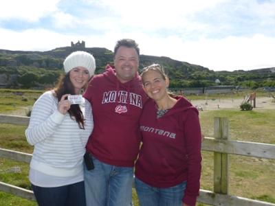 Brandon Tuss '97, middle, his wife, Steph Tuss, right, and Liz Kelly '10 proudly don their Griz gear on Inisheer during a recent trip to Ireland.