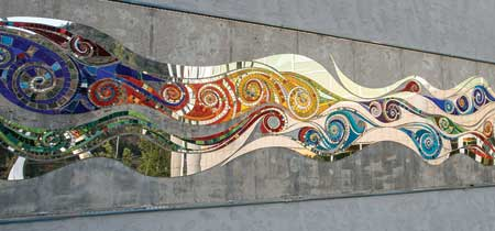An art mosaic decorates an outside space.