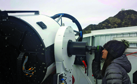 UM student researcher Chantanelle Nava uses UM's 0.7-meter telescope at Mount Hopkins, Ariz., during testing.