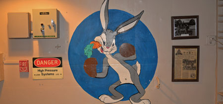 "A Bugs Bunny mural is painted on a wall inside a bunker below a U.S. Air Force base. ""The painting is an homage to a World War II bomber crew,"" says Jeff MacDonald, a CIRE investigator pursuing his doctorate at UM."