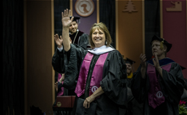 Denise Juneau waves to the crowd at UM Commencement