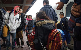 Syrian refugees arrive at Dortmund Central Station in western Germany last summer. At the peak of the past year's refugee crisis in Europe, it was reported that almost 10,000 people a day sought asylum in Germany. (Photo by Shane Thomas McMillan)