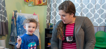Raelynn Cameron, a master's student in early education, wears a GoPro camera while she works with Henry Hamilton, age 4, at her in-home family child care center in East Missoula.